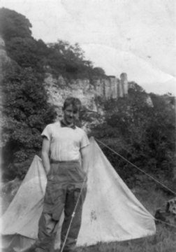 Don Whillans in 1952 with the Tower of Babel behind.